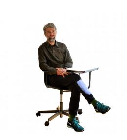 Luke Pearson sitting on SixE Training Chair