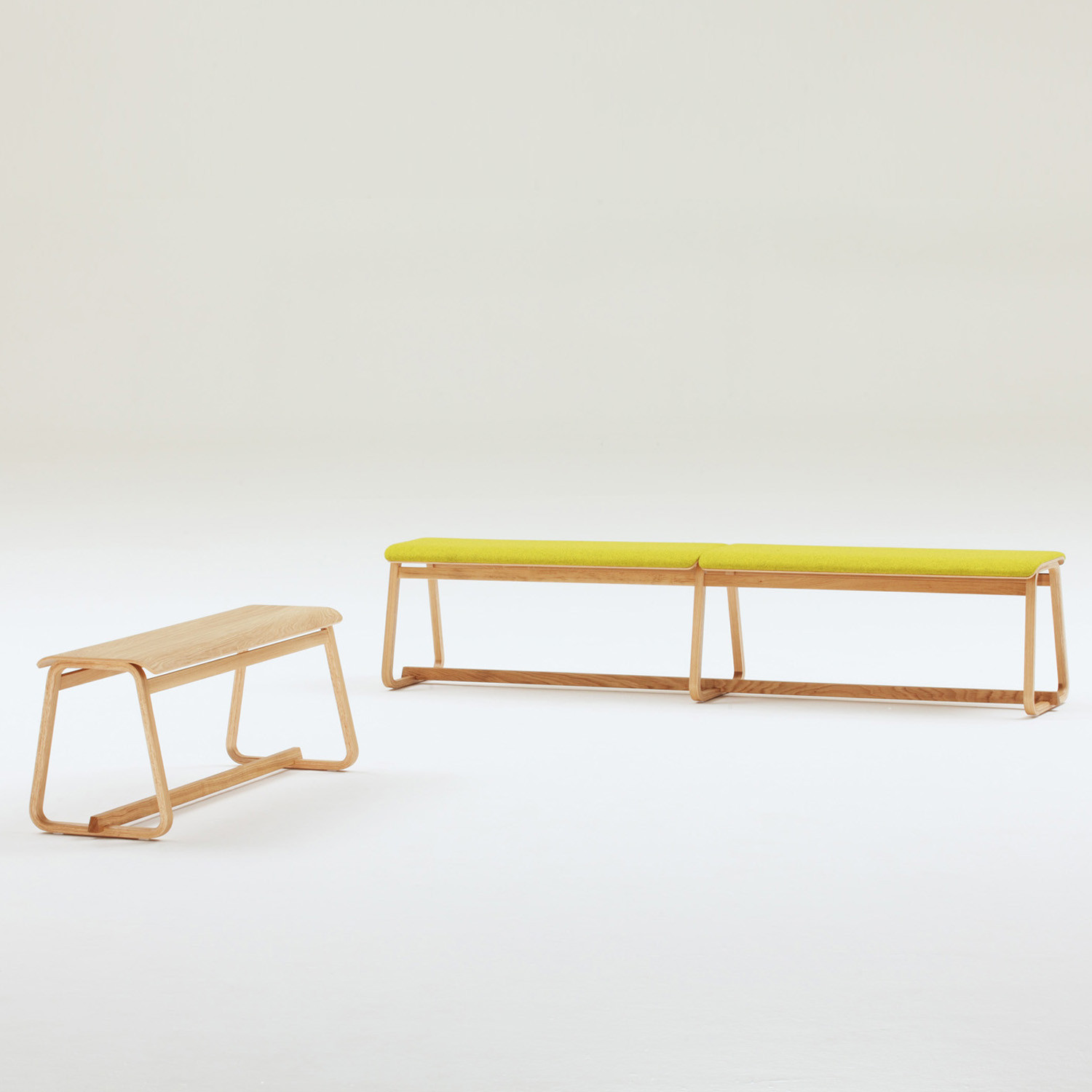 Theo Bench is available with or without upholstery